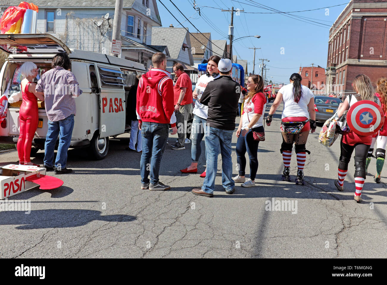 Participants in the 2019 Dyngus Day parade in Buffalo, New York make preparations on the street in the Polonia neighborhood. - Stock Image