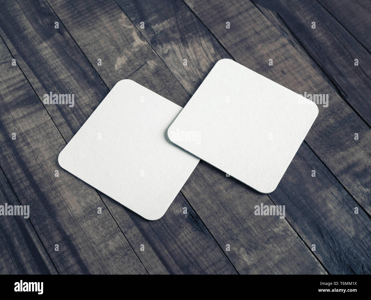 Square beer coasters - Stock Image