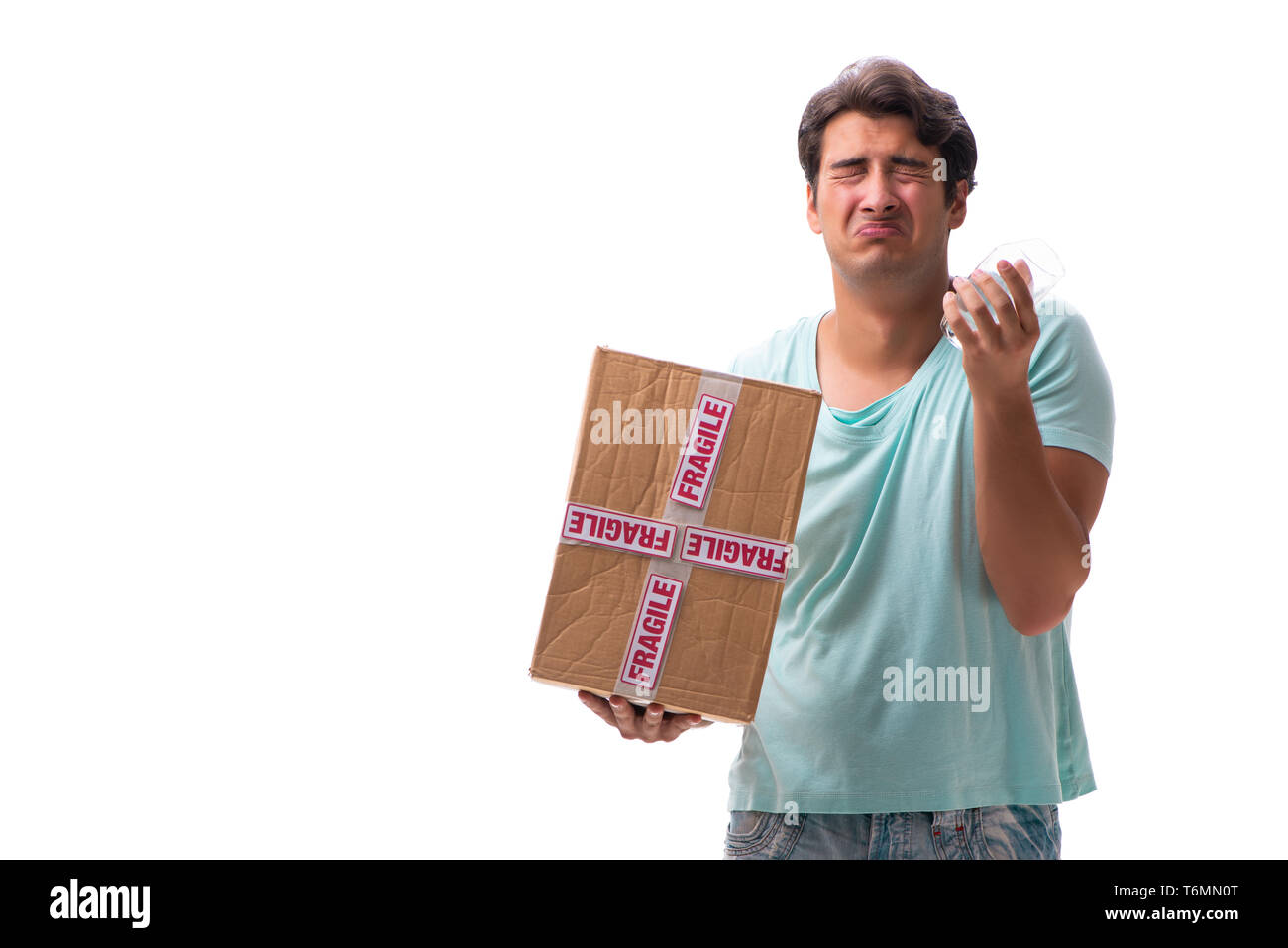 Young handsome man with fragile box ordered from Internet - Stock Image