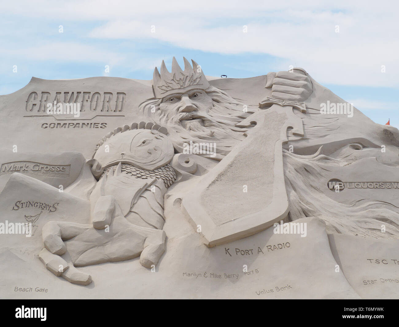 A sword wielding figure dominates one of the large sand sculptures on display at the 2019 Texas Sandfest in Port Aransas, Texas USA. - Stock Image