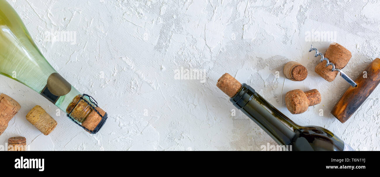 Bottles, wine stoppers and vintage corkscrews. - Stock Image