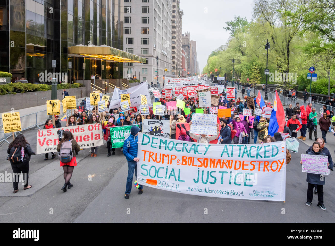 New York, United States. 01st May, 2019. Hundreds of New Yorkers gathered in front of the Trump International Hotel and Tower at Columbus Circle in celebration of May Day - an occasion often synonymous with fighting for workers' rights - in support of issues ranging from fair wages for restaurant workers, to lower tuition costs, to fighting against Trump's proposed border wall. Credit: Erik McGregor/Pacific Press/Alamy Live News Stock Photo