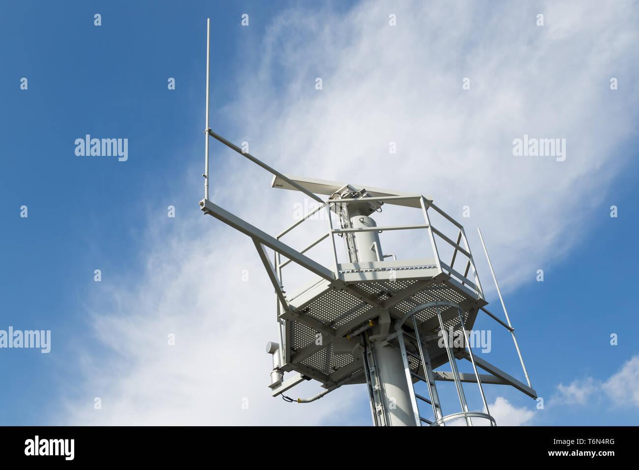 Iron tower with radar and radio communication equipment Stock Photo