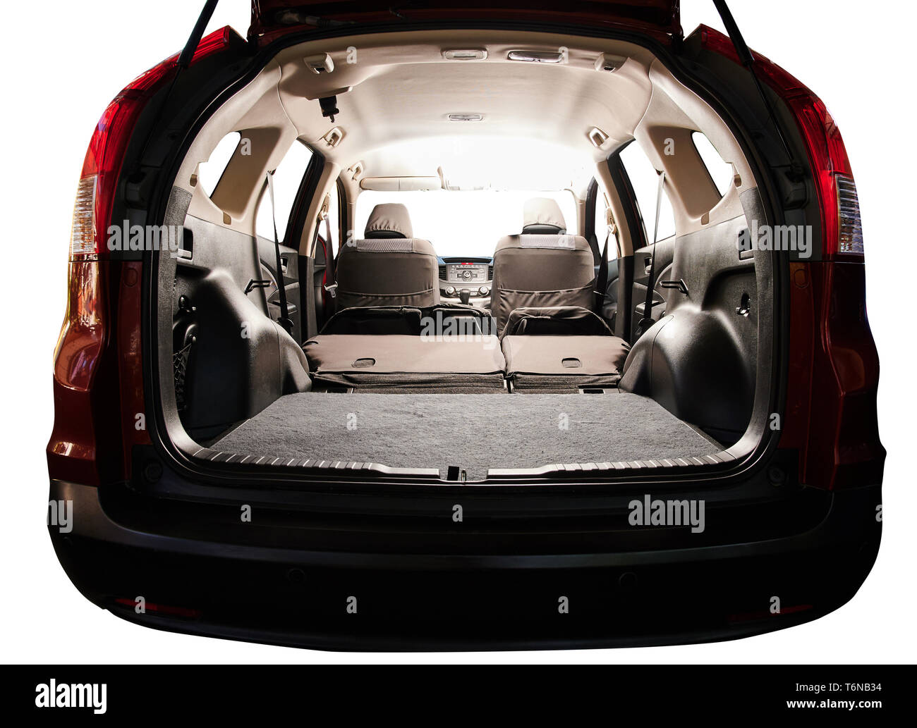 Interior of modern SUV car with open trunk and closed seats - Stock Image