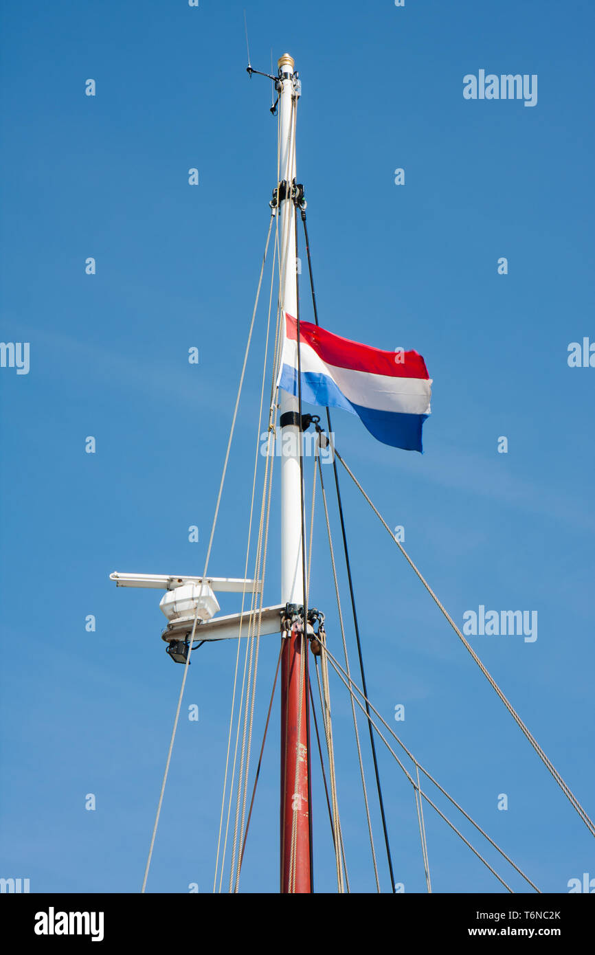 Dutch flag in top of a saling vessel - Stock Image