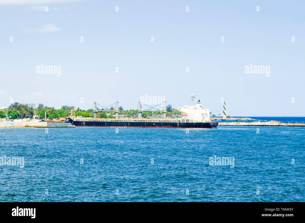 cargo boat arriving at the entrance of the port of Santo