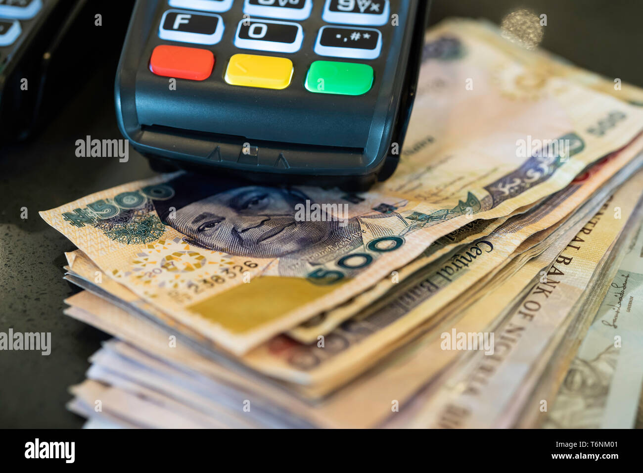 Point of Sale Machine with Nigerian Naira notes Stock Photo