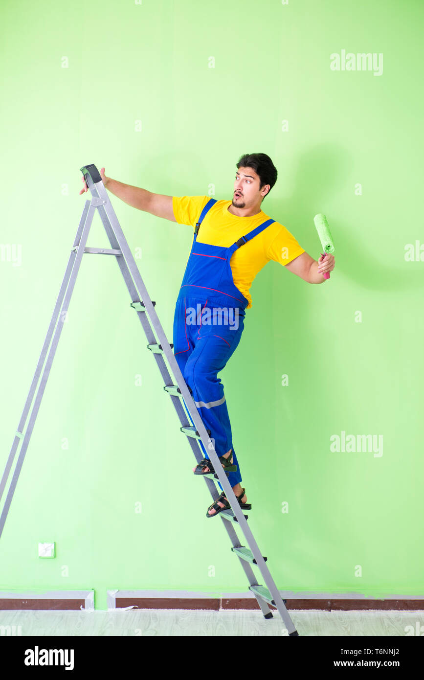 The young painter doing renovation at home - Stock Image