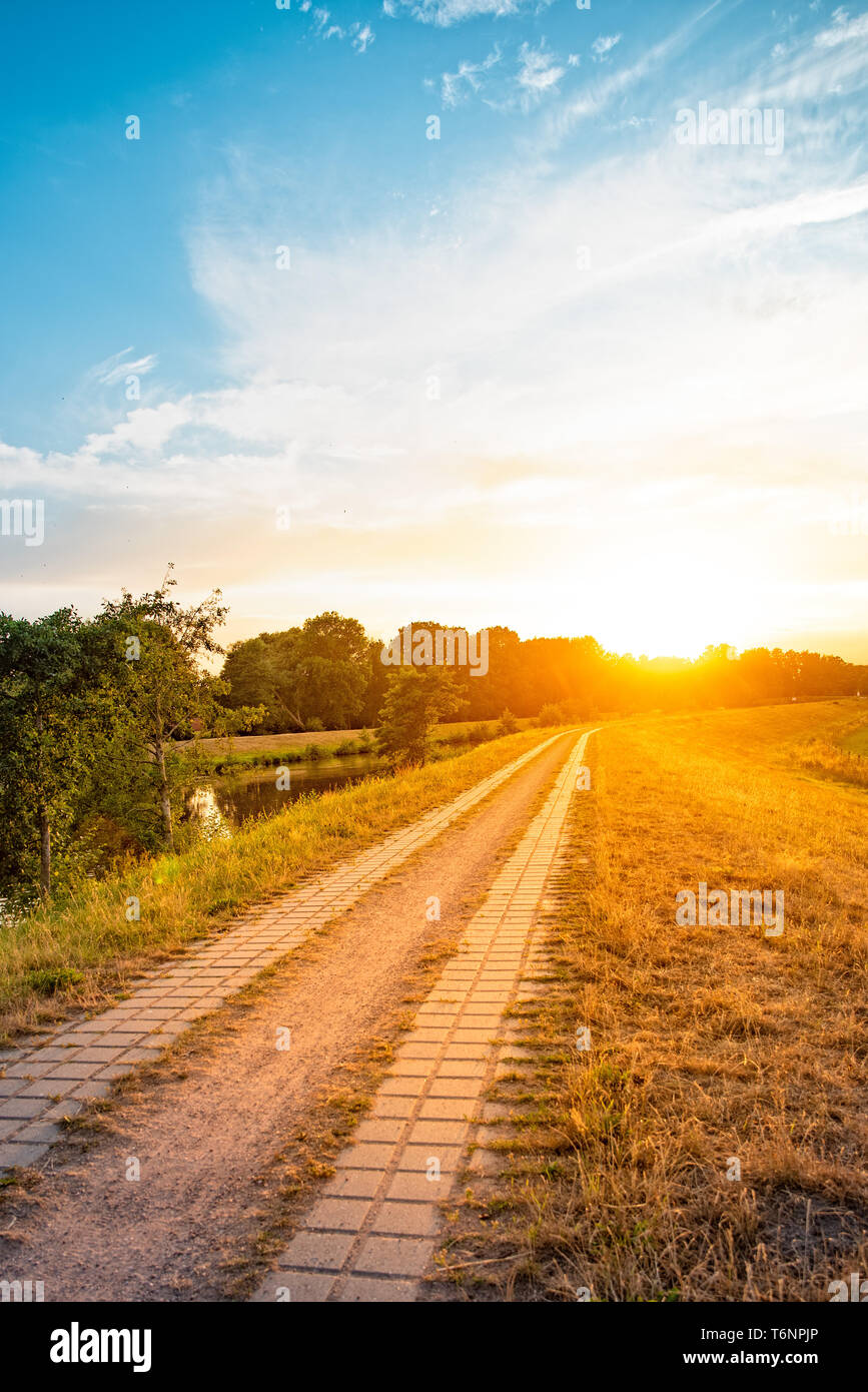 Beauty summery sunset on the Hunte river - Stock Image