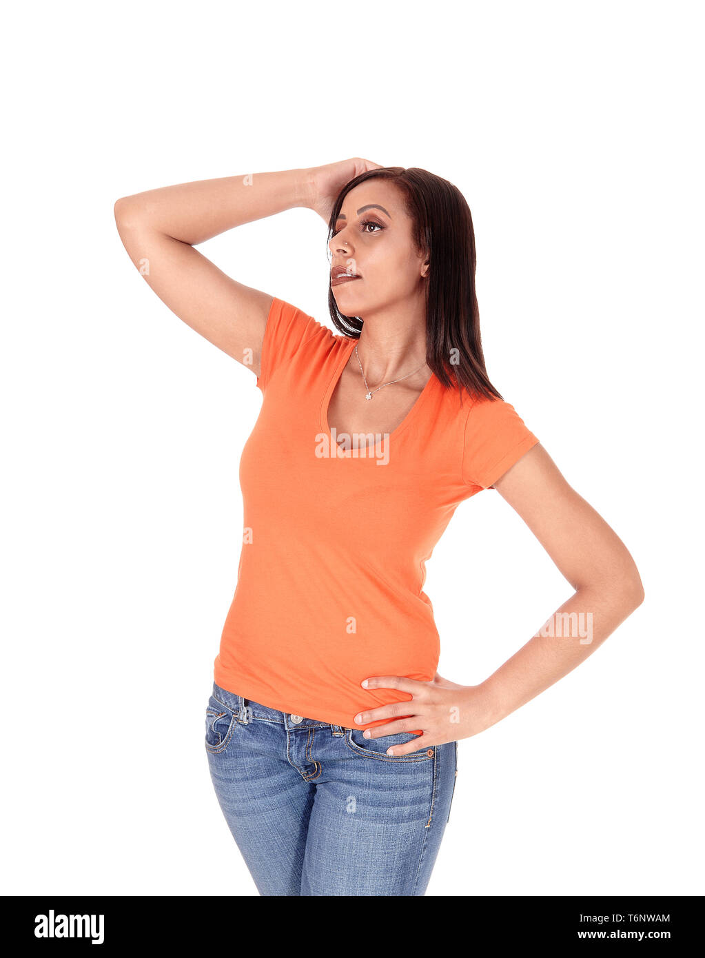 Young pretty woman standing, looking up - Stock Image
