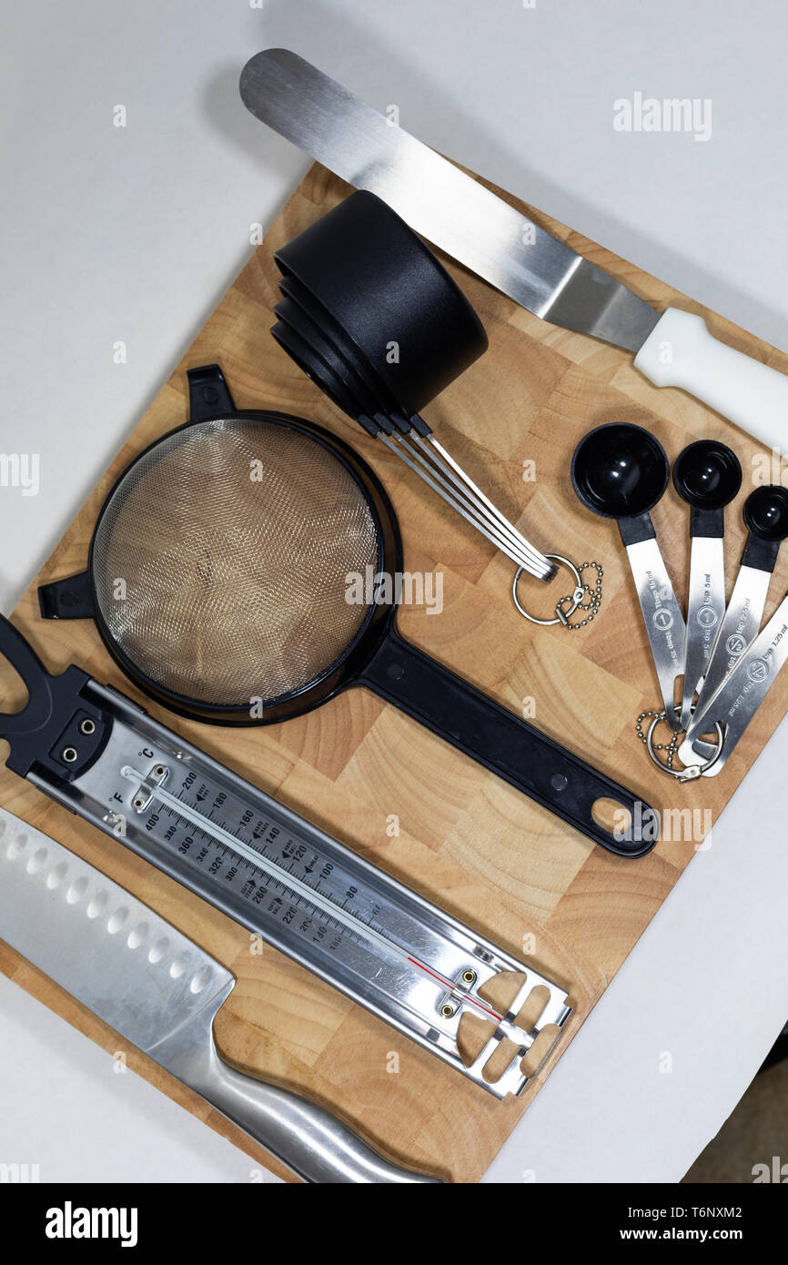 Flat Lay Of Cookingbaking Essential Utensils With Wooden Chopping