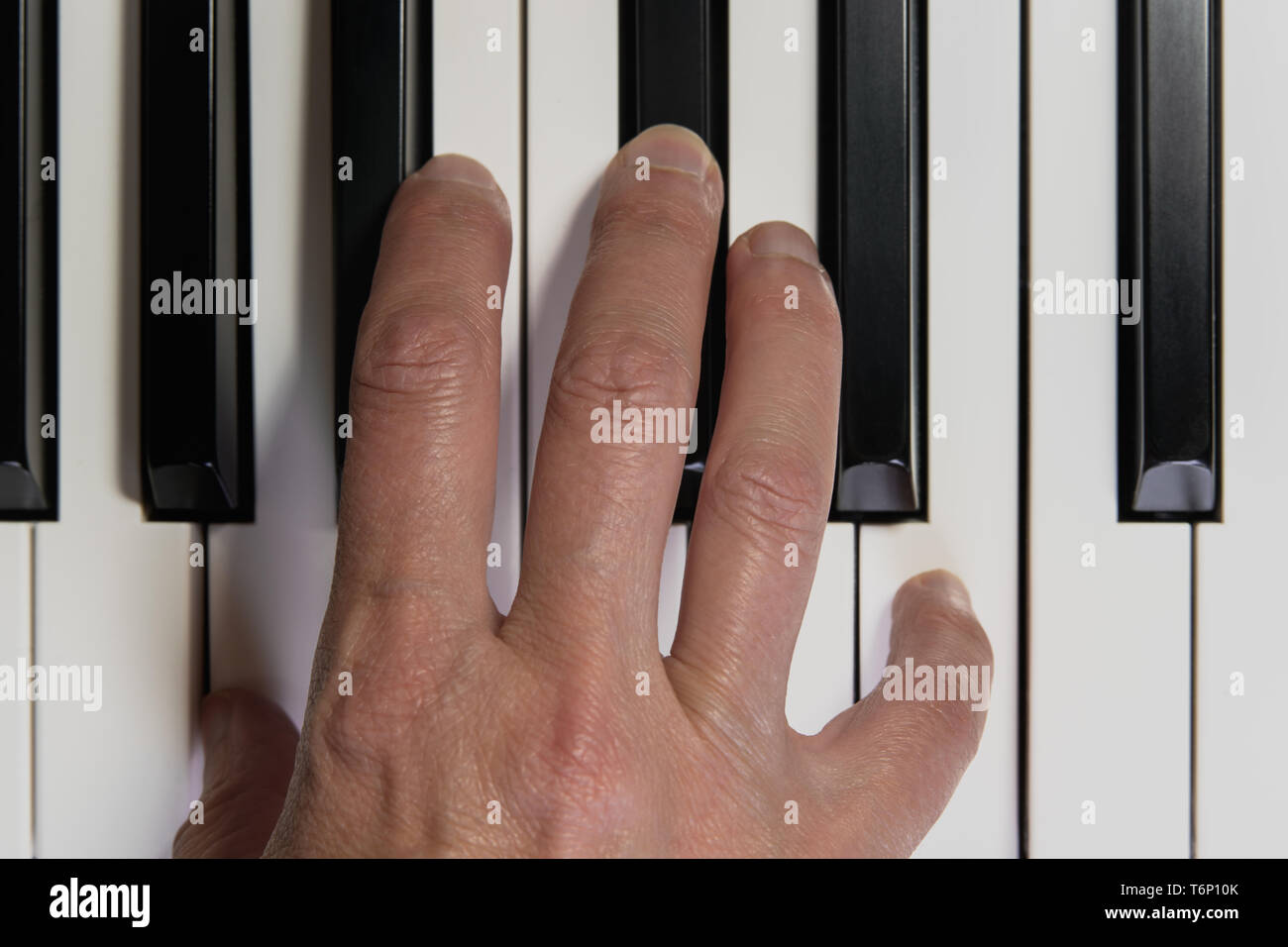 Top View of Piano Keyboard and Hand. Playing Piano. Close Up, Music Instrument, Concept - Stock Image