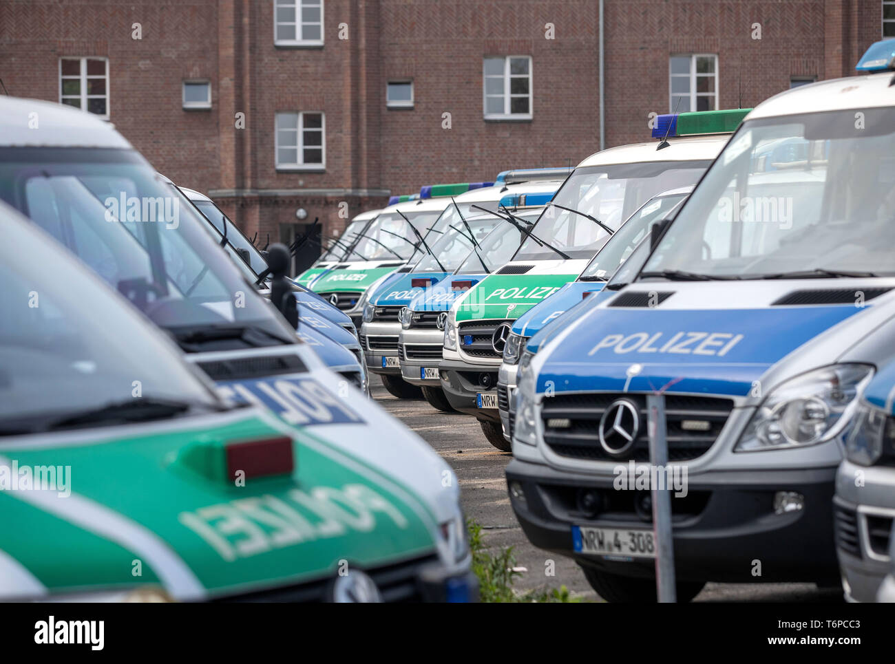 "Duisburg, Germany. 02nd May, 2019. Police trucks are standing in the police barracks in Duisburg. In connection with a right-wing demonstration in Duisburg, a sticker of the right-extremist group ""Identitäre Bewegung"" has been discovered in a police van. North Rhine-Westphalia's Interior Minister Reul (CDU) considers it ""very likely"" that one of the ""usually"" six police officers transported in the car attached the sticker there. On the occasion of a visit to Greece, Reul called the process ""intolerable, not to accept at all"". Credit: Christoph Reichwein/dpa/Alamy Live News Stock Photo"
