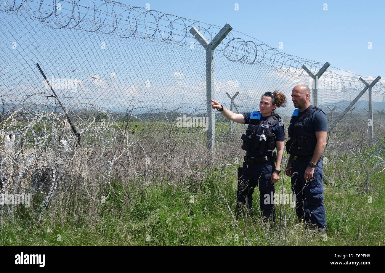 02 May 2019, Greece, Thessaloniki: The North Rhine-Westphalian police officers Muna Mougawaz and Alexander Rankovic are working for the EU border protection organisation Frontex at the border fence between Greece and North Macedonia. North Rhine-Westphalia's Interior Minister Reul visited North Rhine-Westphalian police officers who, as part of the EU border protection agency Frontex, are helping to secure the Greek border with northern Macedonia. The main aim of the officials is to prevent refugees and migrants from illegally arriving in Central Europe from Northern Macedonia. Photo: Alexia An Stock Photo