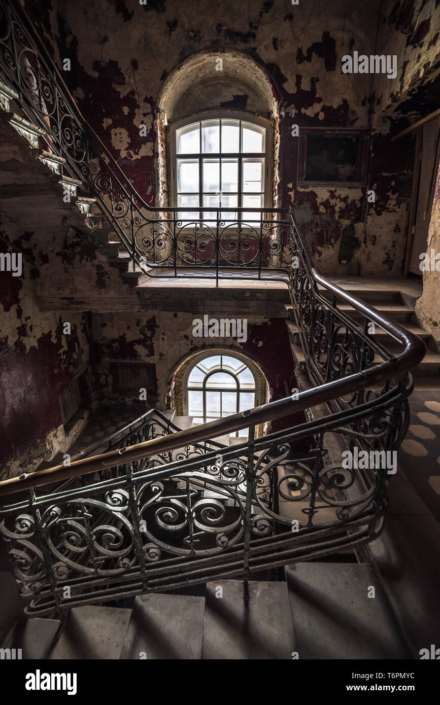 Decaying staircase in an abandoned house - Stock Image