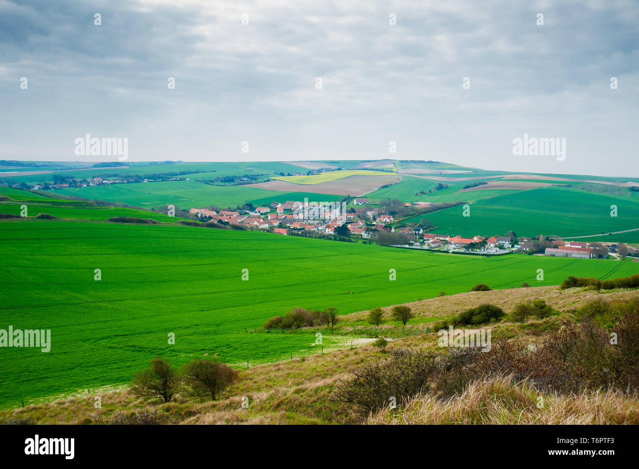 view on the landscape and the village l' Escale when mounting the cliff of Cap Blanc Nez in springtime in the region of Nord Pas de Calais - Stock Image