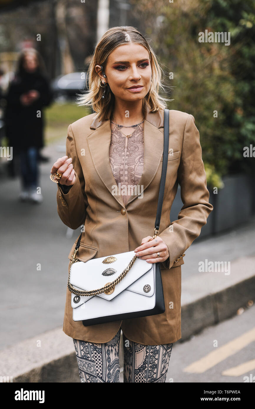 Milan, Italy - February 23, 2019: Street style – Outfit after a fashion show during Milan Fashion Week - MFWFW19 - Stock Image
