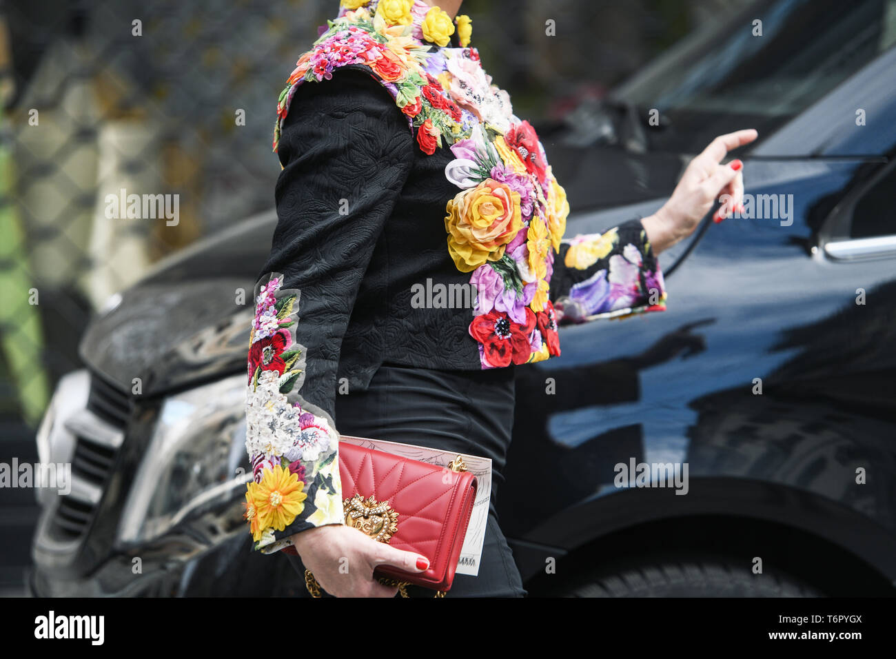 Milan, Italy - February 24, 2019: Street style – Dolce & Gabbana outfit after a fashion show during Milan Fashion Week - MFWFW19 - Stock Image