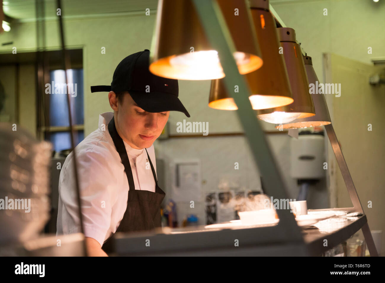 Young Sous-Chef preparing food - Stock Image