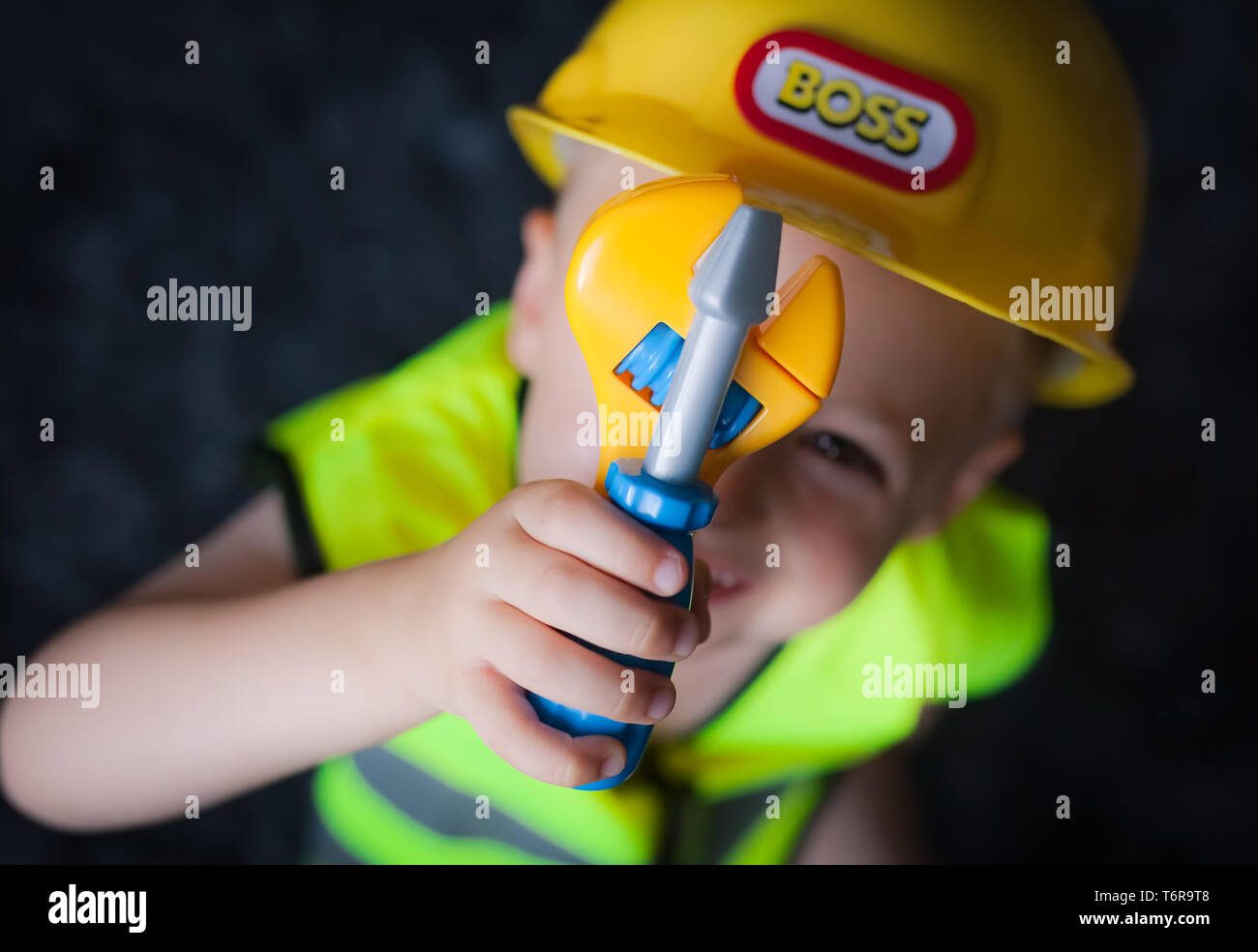 Little boy dressed as foreman builder - Stock Image