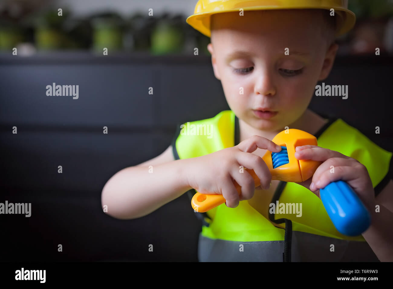 Boy playing as a foreman - Stock Image