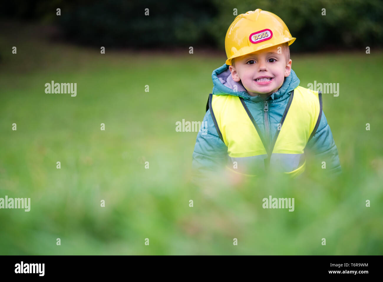 Boy pretending to be a builder foreman - Stock Image