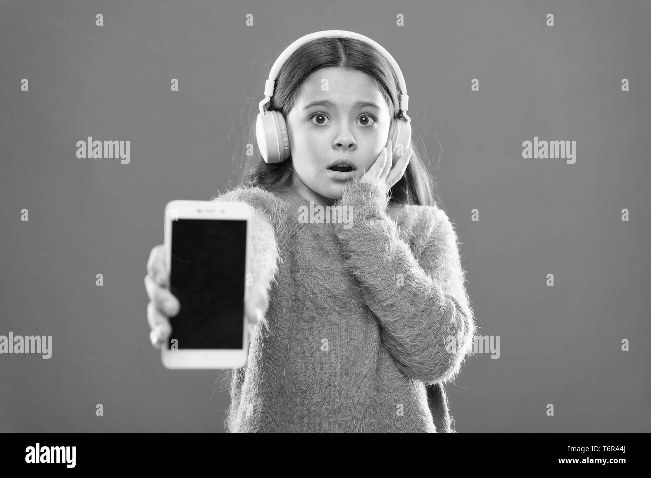 Outdated application version. Best free music apps. Listen for free. Get music account subscription. Enjoy music concept. Enjoy perfect sound. Girl child listen music modern headphones and smartphone. - Stock Image