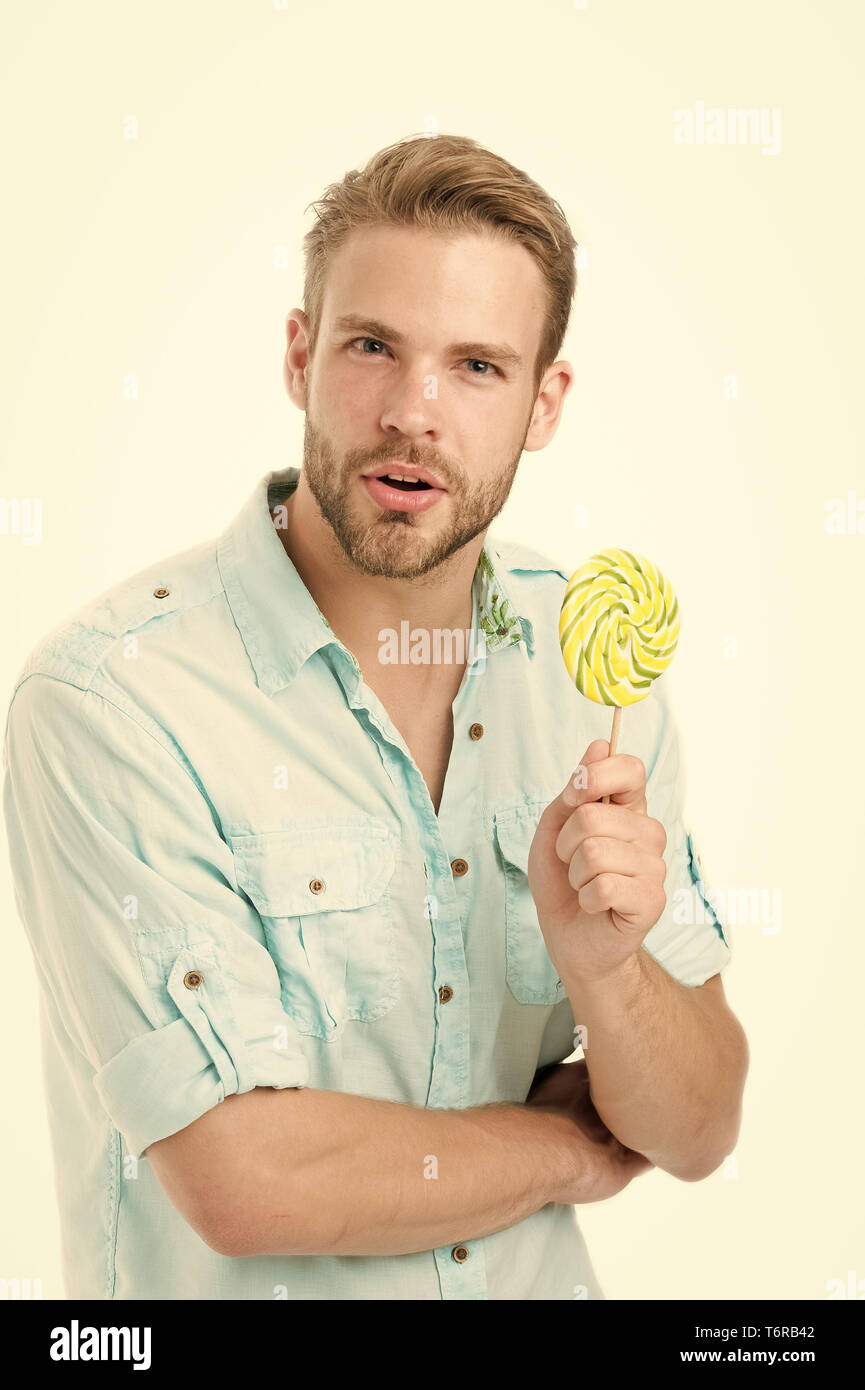 Do you know. Impressing fact harmful sugar nutrition. Man handsome bearded guy holds lollipop candy. Man with lollipop looks puzzled. Healthy nutrition and dieting concept. Harmful effect of sugar. - Stock Image
