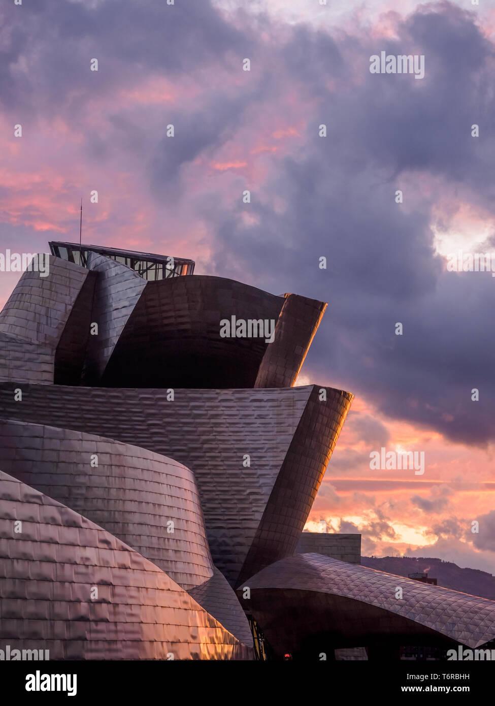 Bilbao riverside near Guggenheim Museum during the sunset, view from La salve bridge - Stock Image
