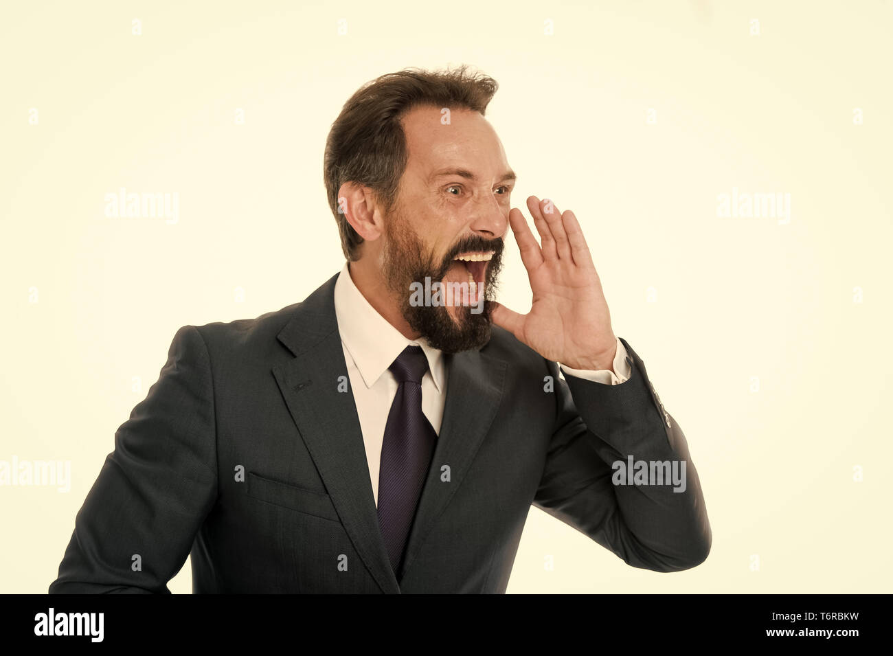 Overwhelming rumors. Businessman classic formal suit shouting loudly overwhelming news. Charismatic person achieves success easier. Businessman shouting face informing important. Do you hear me. Stock Photo