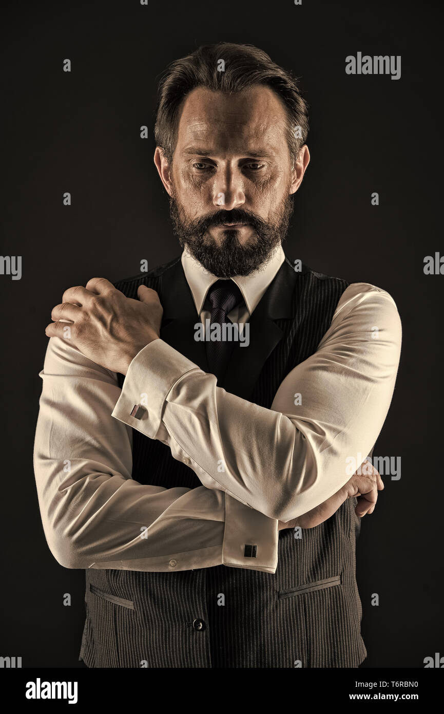 Experienced businessman. Businessman classic formal clothing hold hands crossed on chest. Business advice more experienced entrepreneur. Man thoughtful face calm confident with wrinkles and beard. - Stock Image