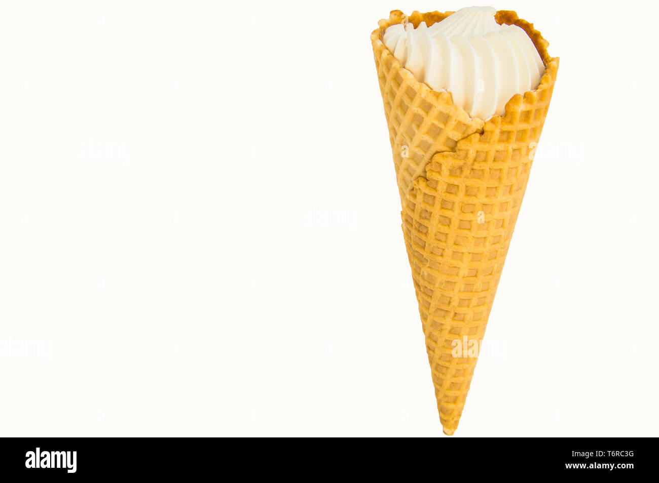 Waffle vanilla ice cream cone isolated on white background by clipping with copy space. - Stock Image