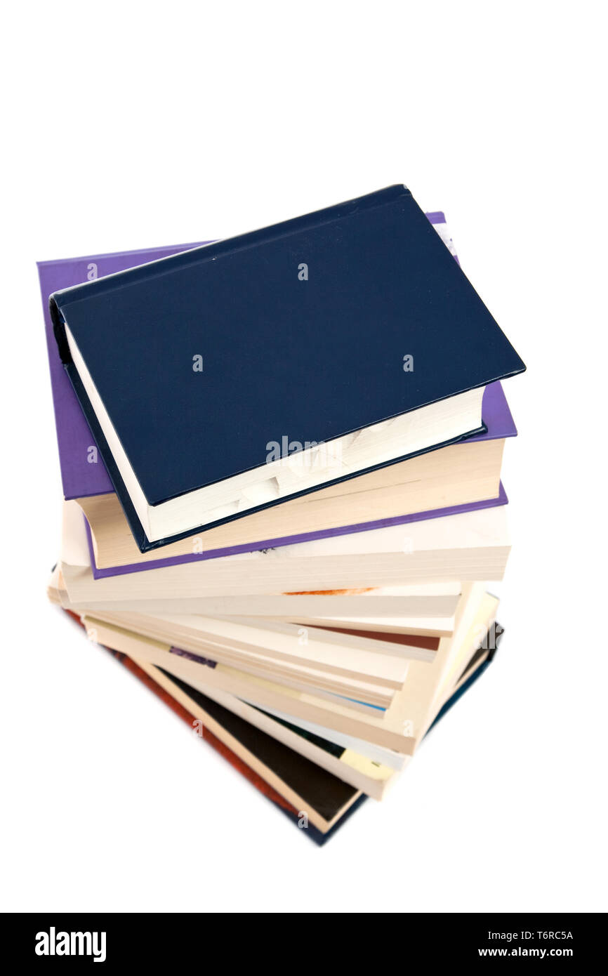 lots of books with colorful covers on white background - Stock Image