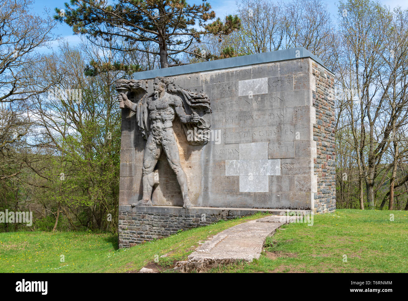 Nazi statue of a torchbearer at Vogelsang College, Eifel, Germany - Stock Image