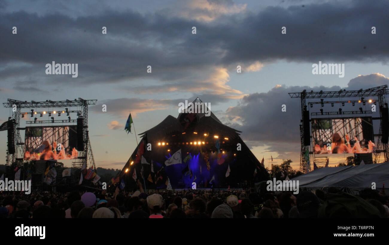 Glastonbury Music Festival Pyramid Stage at Sunset - Stock Image