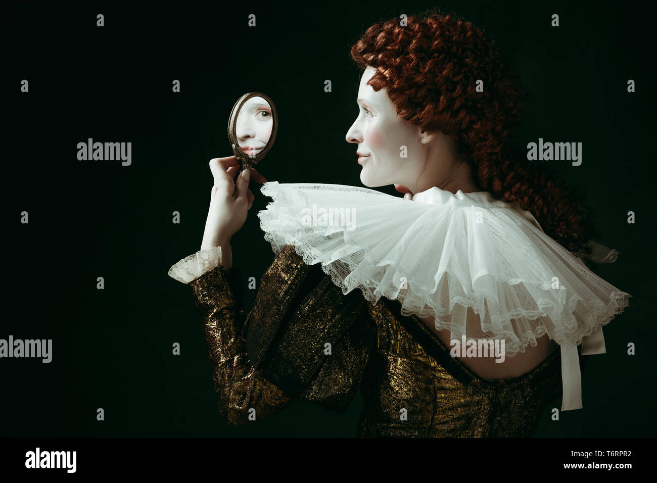 e62151ec8db Who s that pretty. Medieval redhead young woman in golden vintage clothing  as a duchess looking