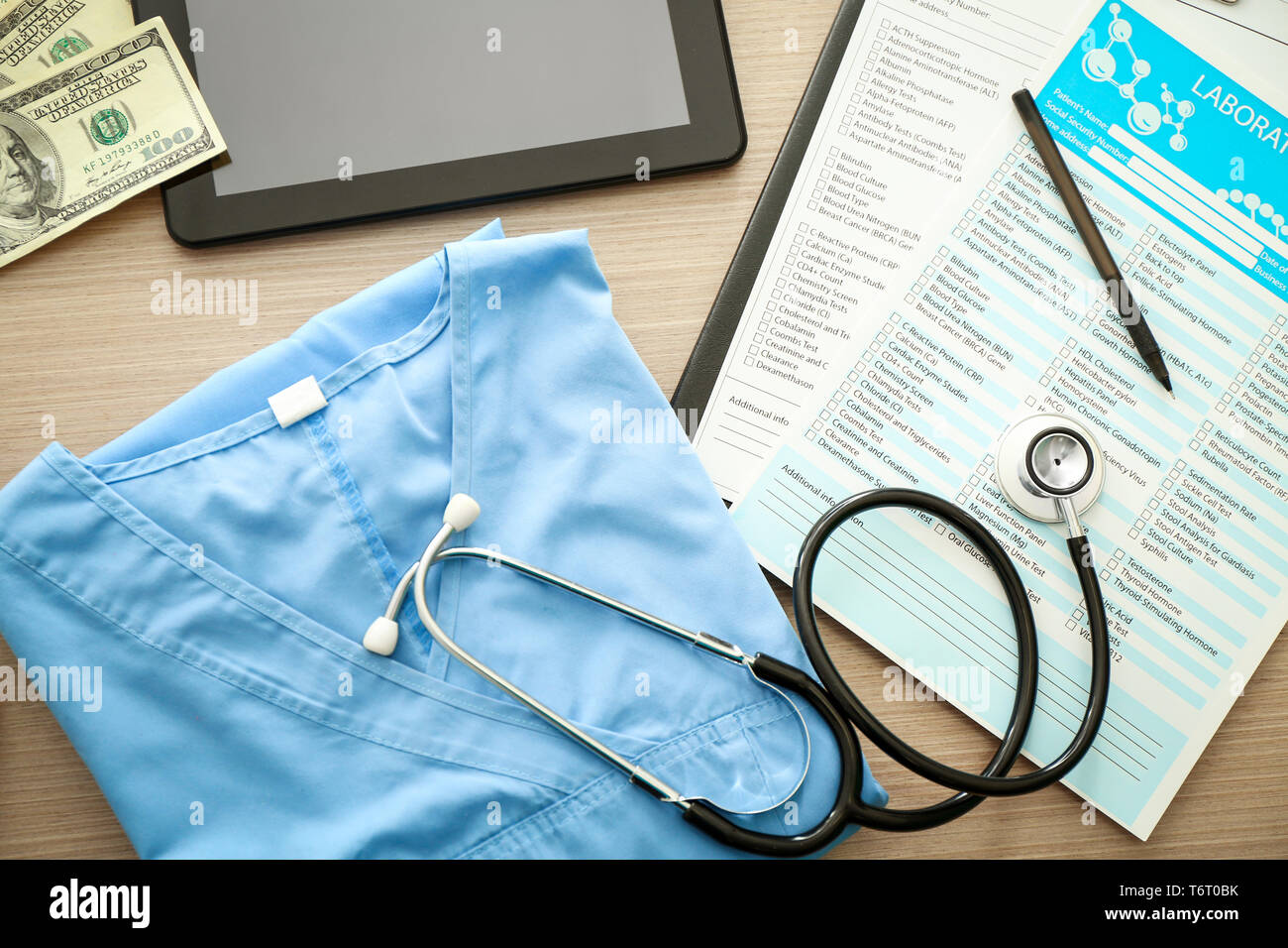Stethoscope with blue doctor's uniform and laboratory tests