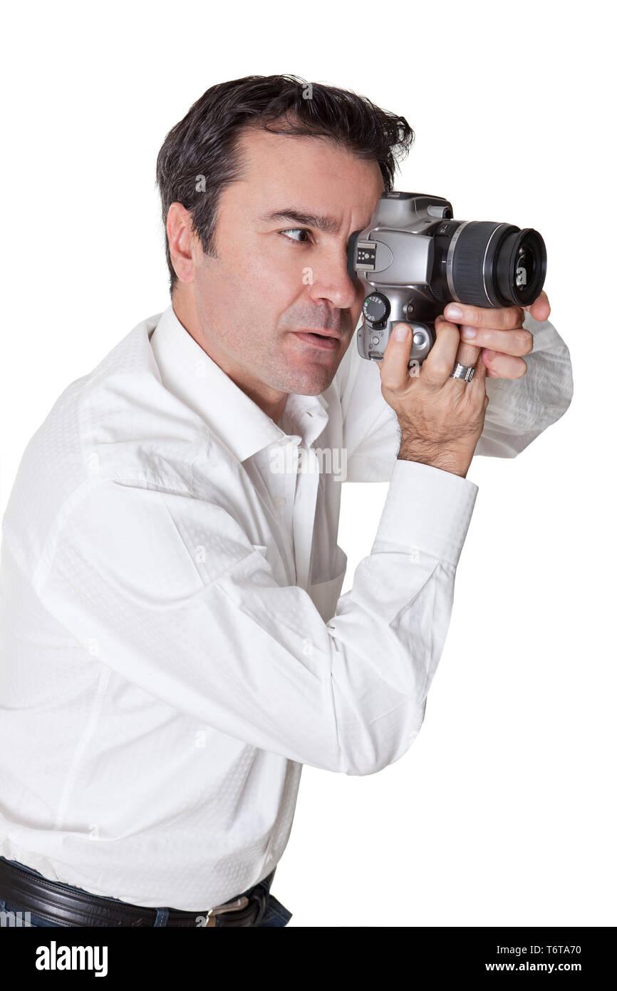 senior man shooting photos with a dijital slr on white - Stock Image