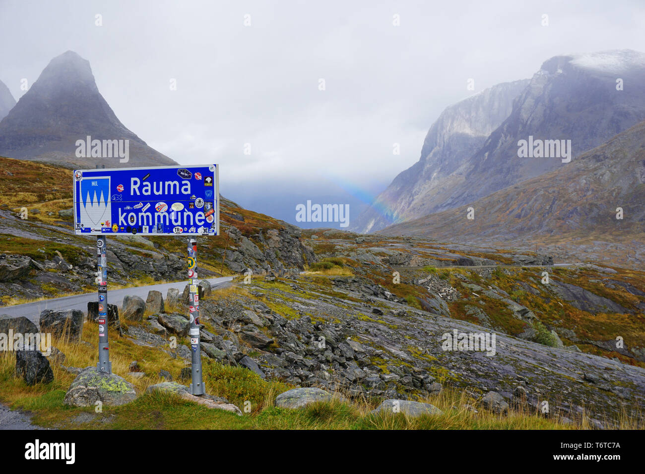 Rauma location sign - serpentine mountain road in norway - Stock Image