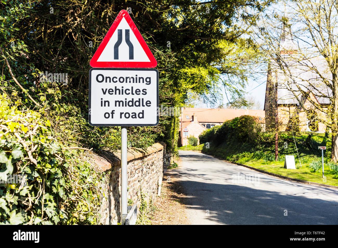 Oncoming vehicles road sign, Oncoming vehicles in middle of road sign, UK road sign, UK road signs, warning, sign, signs, UK, road narrows sign, - Stock Image