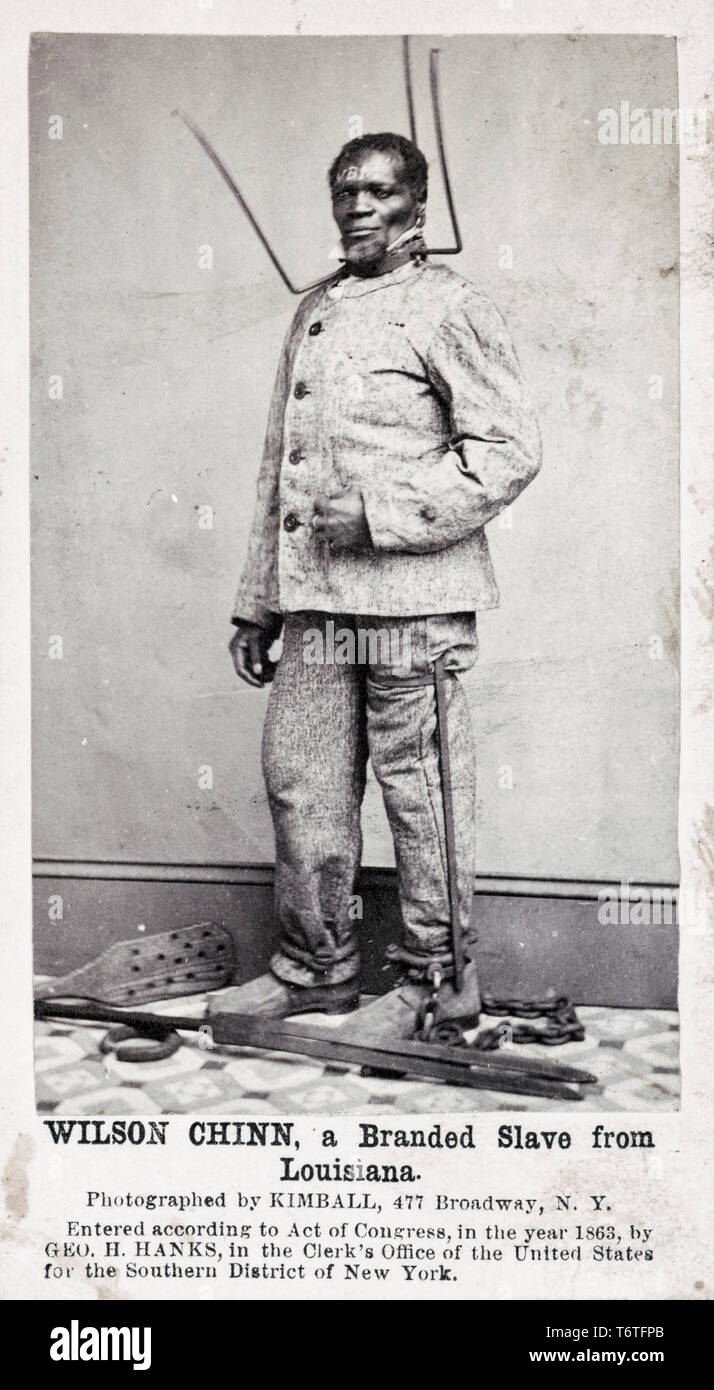 Wilson Chinn, a branded former slave from Louisiana, wearing a punishment collar and leg irons and chains, American slavery, 1863 - Stock Image