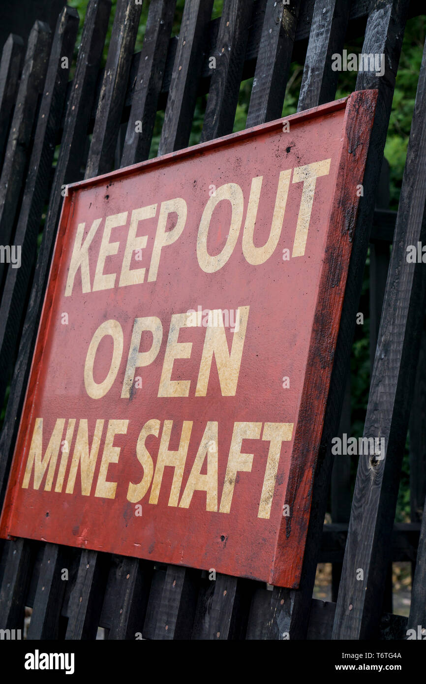 'Keep Out Open Mine Shaft' public warning sign to tourists at Black Country Living Museum, Dudley, UK, visiting the colliery site. - Stock Image