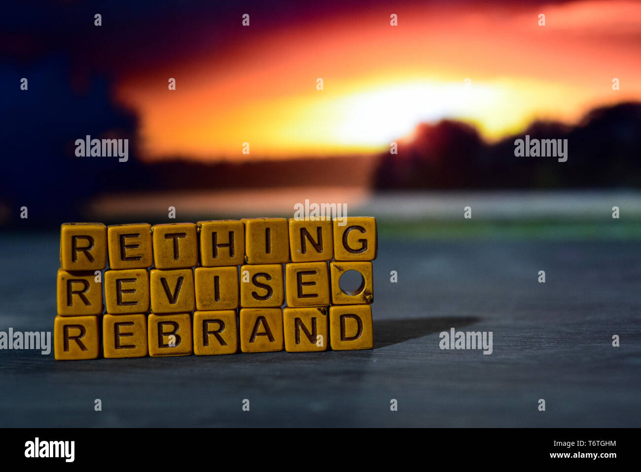 Rethink - Revise - Rebrand on wooden blocks. Cross processed image with bokeh background - Stock Image