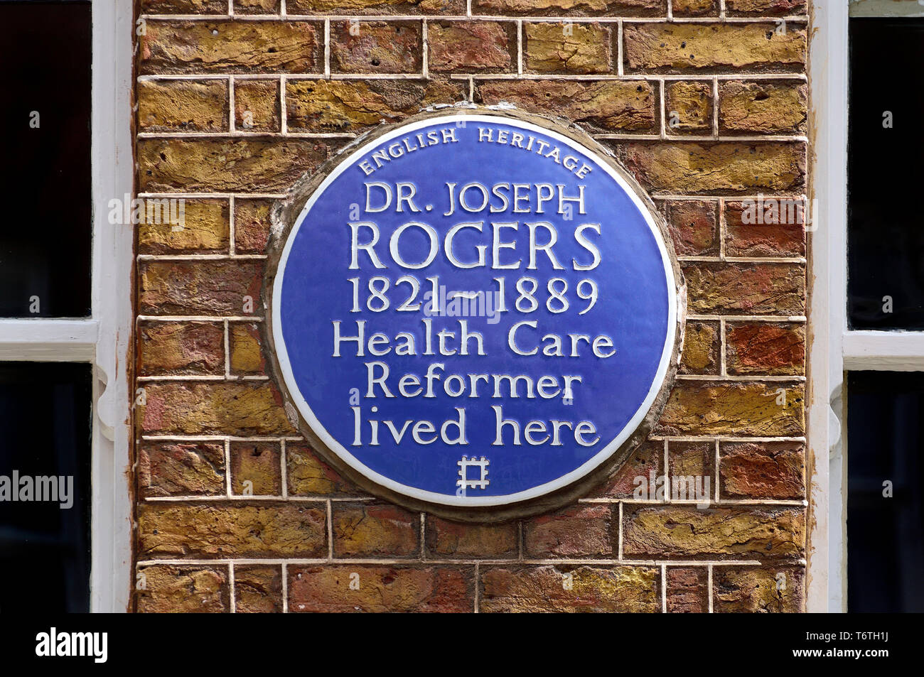 London, England, UK. Commemorative Blue Plaque: Dr Joseph Rogers (1821-1889) health care reformer lived here. 33 Dean Street, Westminster - Stock Image