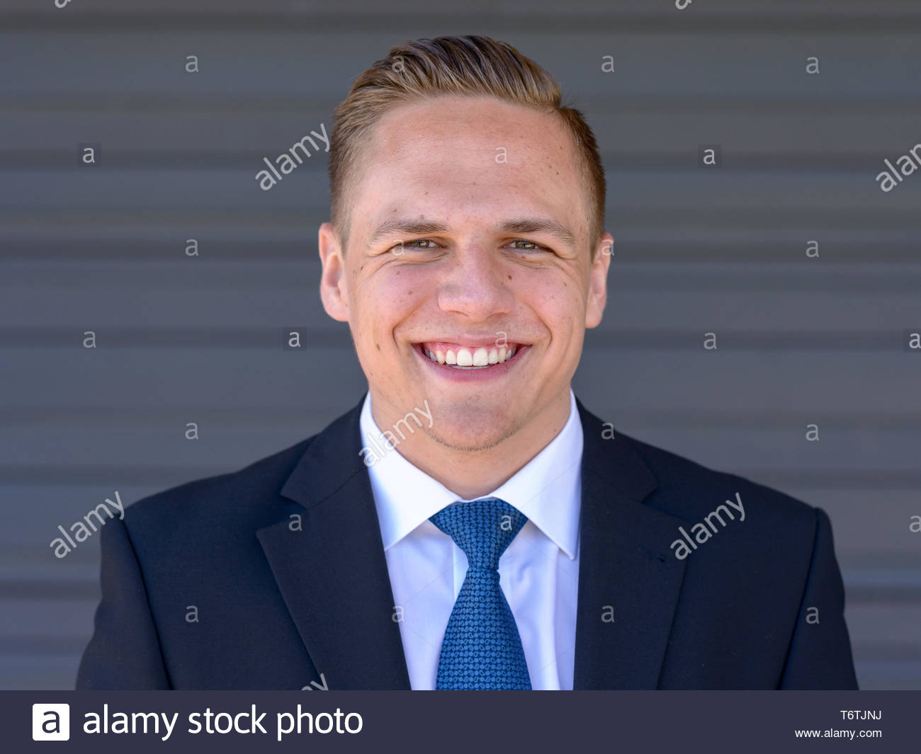 Happy young businessman with a beaming smile - Stock Image