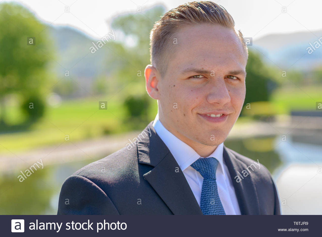 Young professional man with a beaming smile - Stock Image