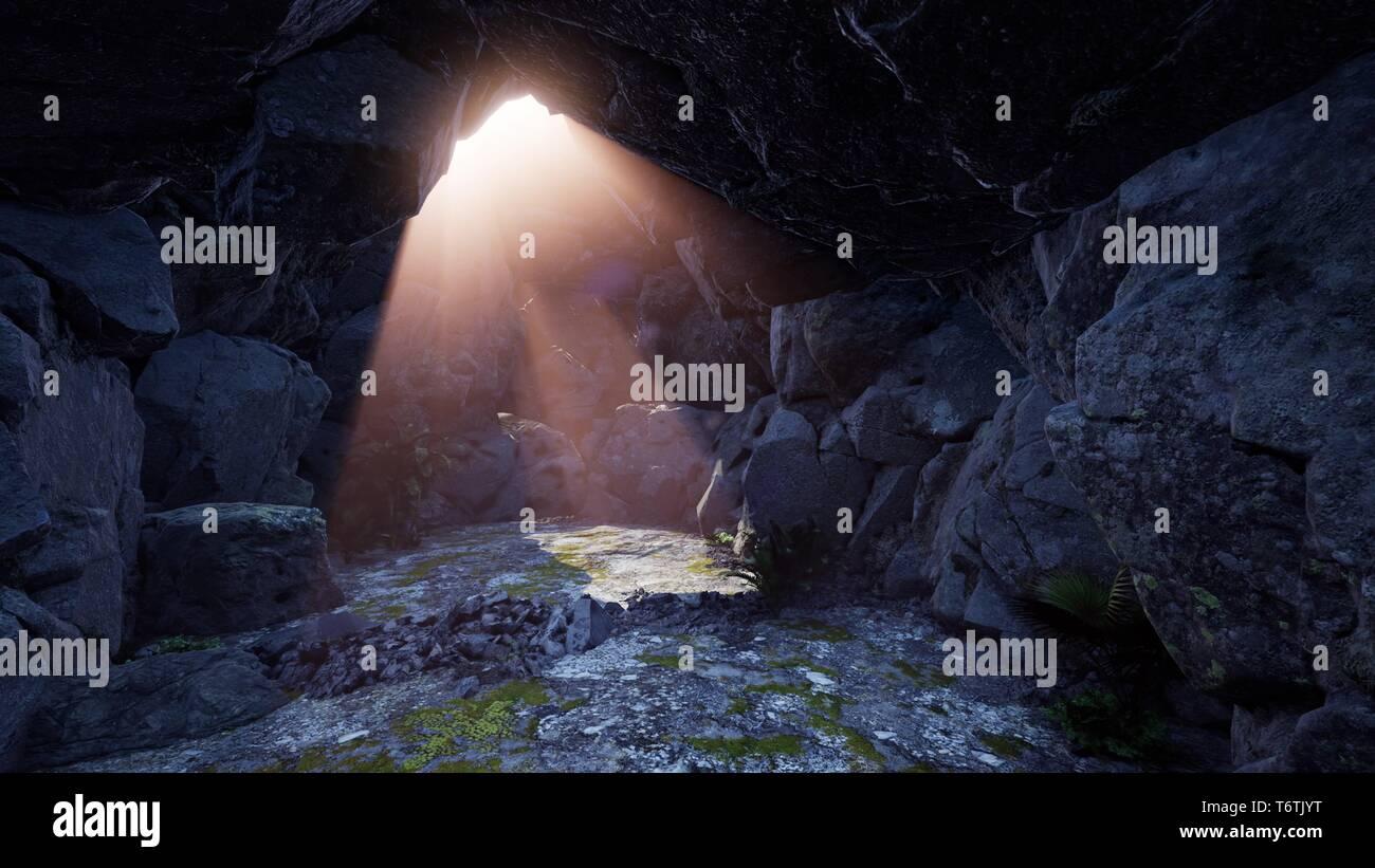 4k sun light inside beautiful mysterious cave - Stock Image