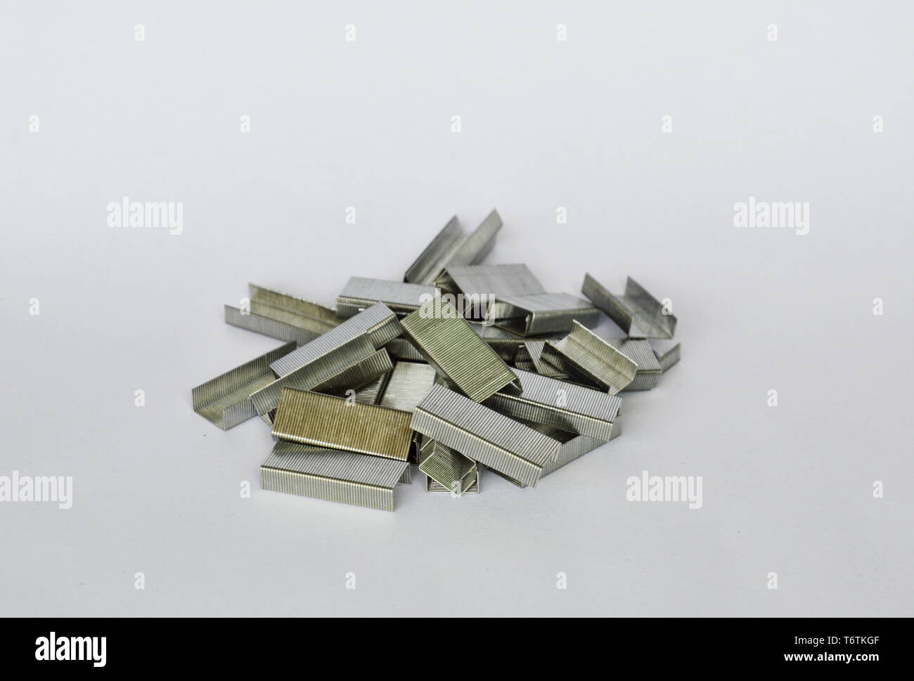 stapler wire for refill on white background - Stock Image