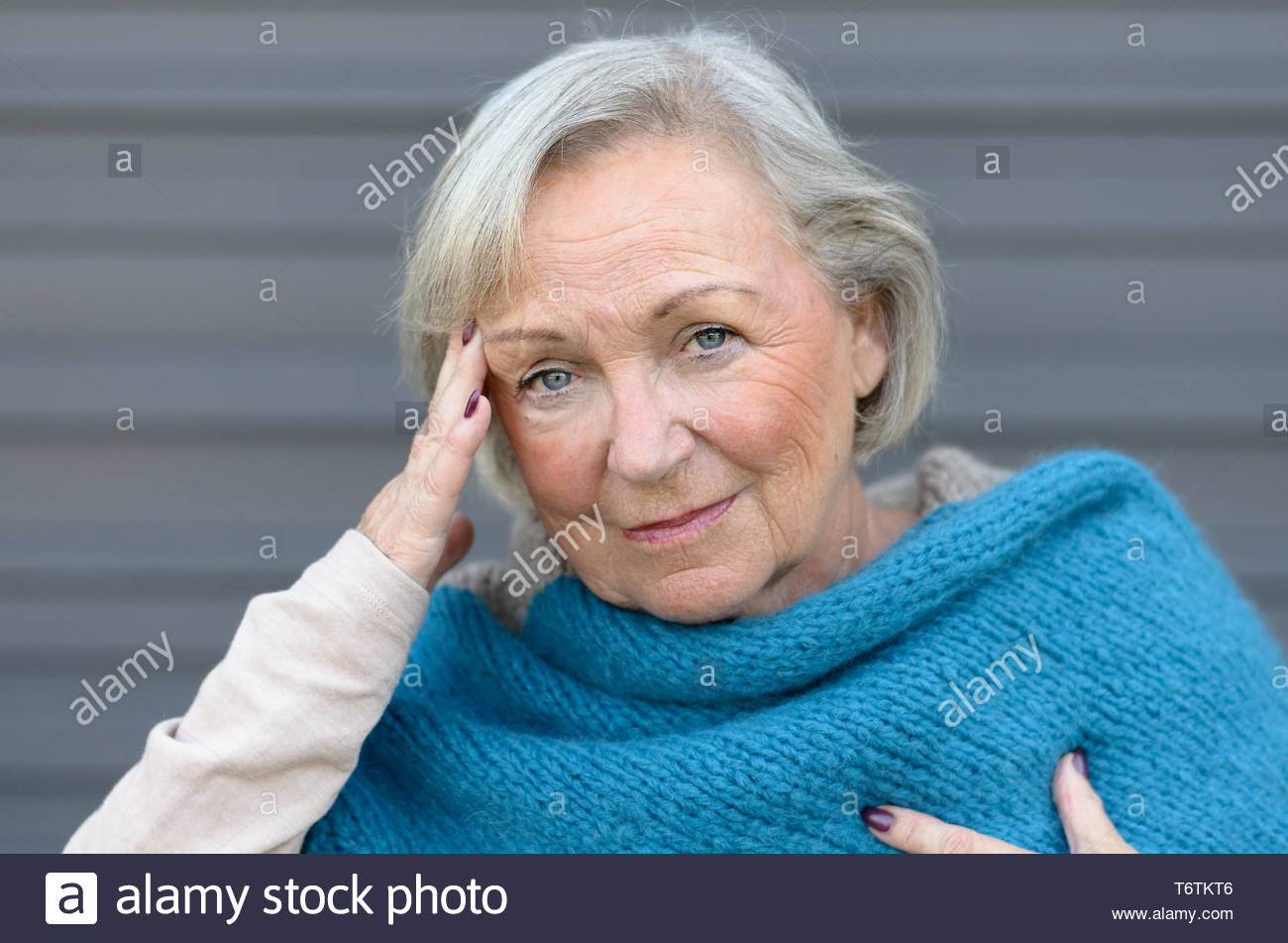 Elderly elegant woman with a headache - Stock Image