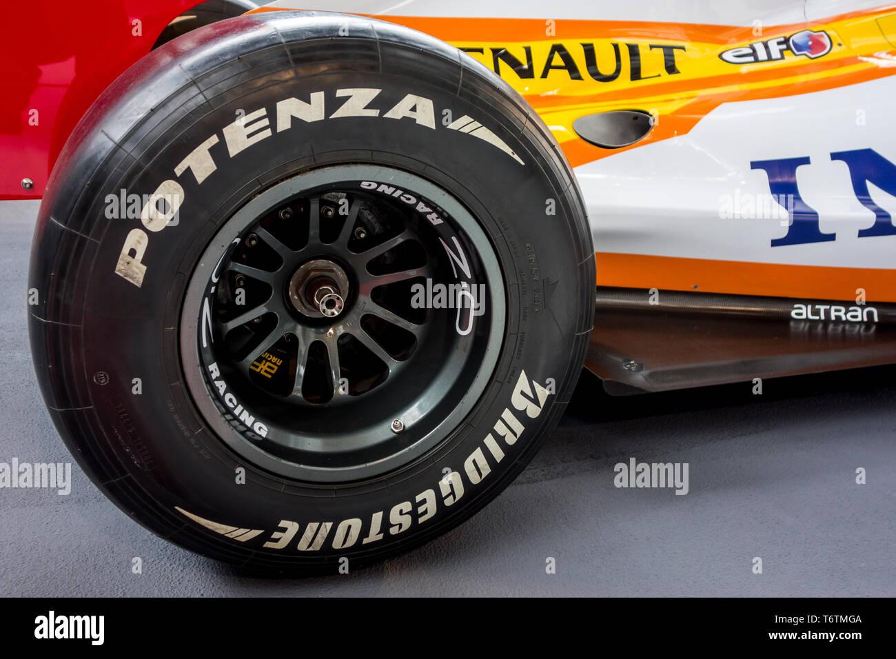 Close-up of Bridgestone Potenza F1 rear racing slick tyre / tire on Renault R28 racing sports car / sports racing car / race car - Stock Image